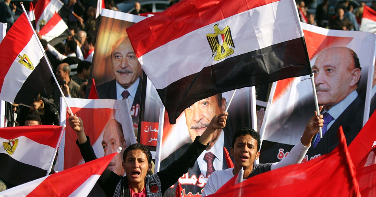 Egyptian supporters hold up portraits of ex-chief of intelligence and vice president Omar Suleiman in Cairo on December 2, 2011. Suleiman announced on April 6, 2012, that he would run during Egypt's presidential elections next month.</p>