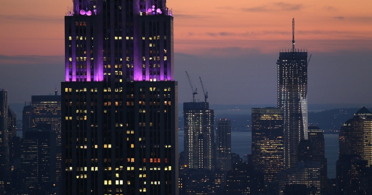 The Empire State Building (L), towers over the Manhattan skyline as the One World Trade Center building (R), stands downtown on February 13, 2012.</p>