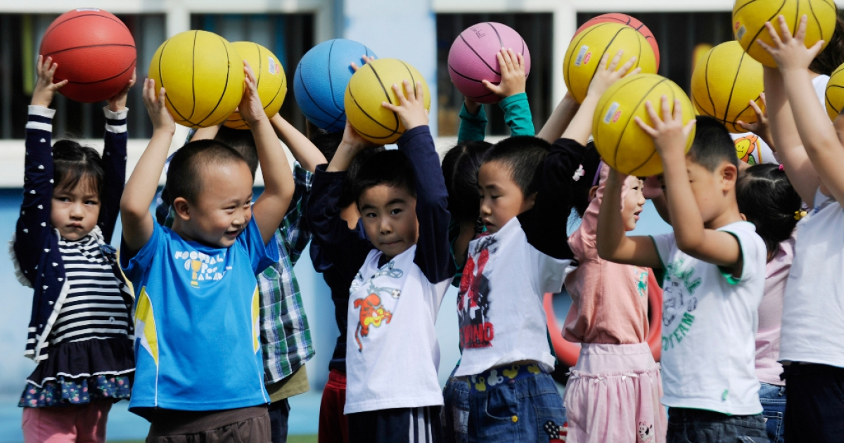 Children playing at a kindergarten in Beijing.</p>