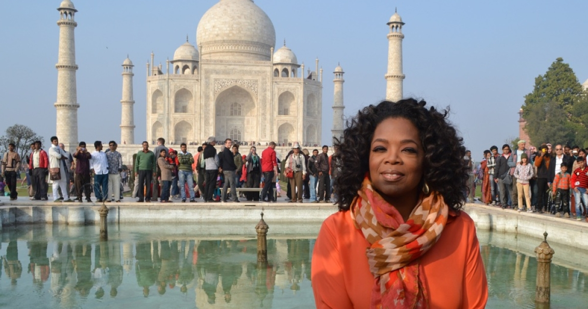 Oprah Winfrey poses in front of the Taj Mahal on January 19, 2012.</p>