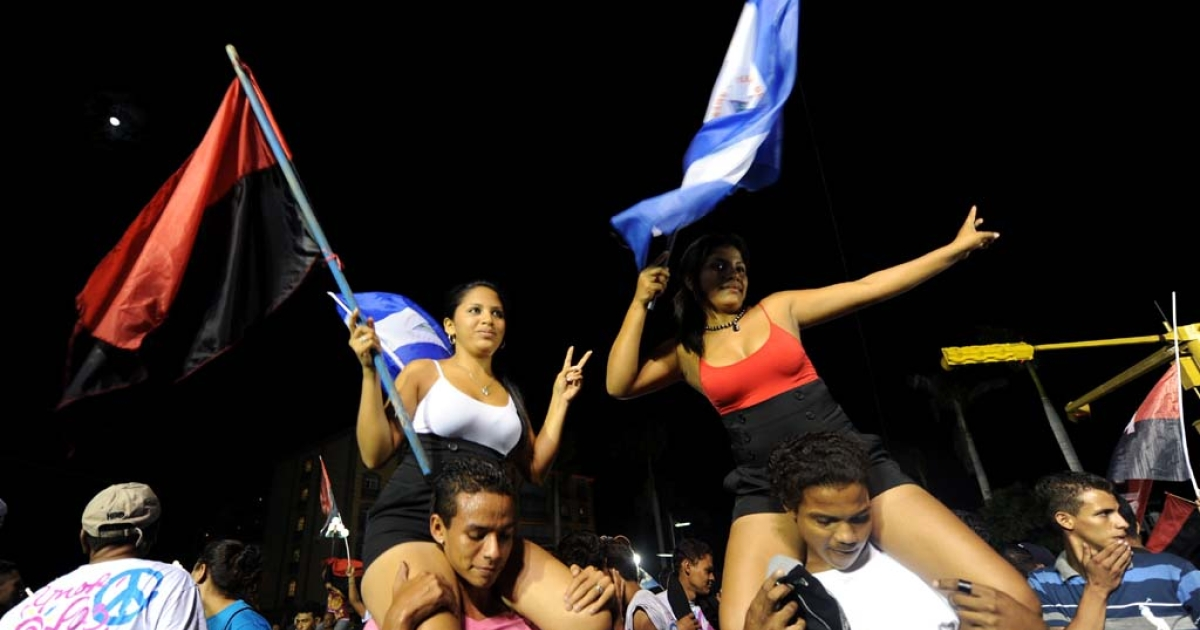 Supporters of Nicaraguan President and presidential candidate Daniel Ortega celebrate following the presidential election in Managua on November 6, 2011. Former Marxist guerrilla leader Daniel Ortega won a third term in office, according to his wife and spokeswoman, after partial results gave him a strong lead in presidential polls.</p>