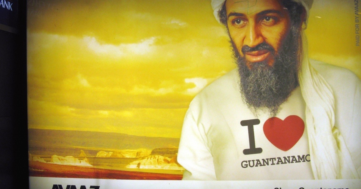 A billboard with Osama bin Laden wearing an 'I love Guantanamo' t-shirt is on display at Farragut North Metro Station in Washington D.C. in September 2009.The billboard is an advertisement from Avaaz.org, an organization that launched a metro billboard campaign to remind policymakers that torture is a top recruiting tool for al-Qaeda leader Osama bin Laden and his network.</p>