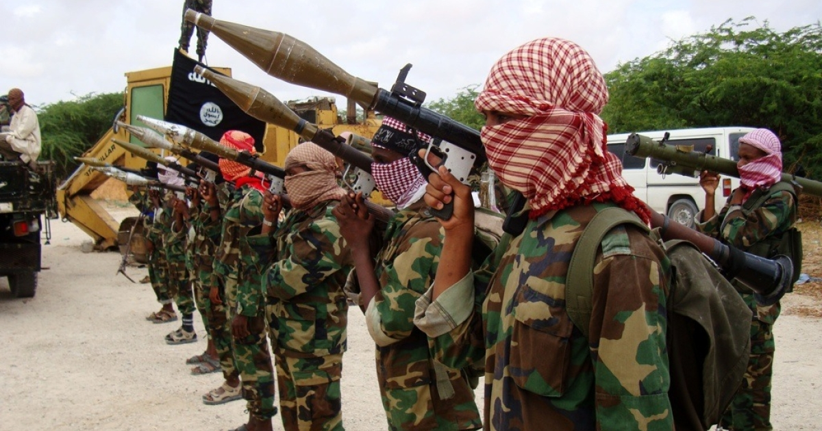 Militants belonging to Somalia's Al Qaeda-inspired Al Shabaab Islamists stand in formation on October, 21, 2010 during a show of force in Somalia's capital Mogadishu.</p>