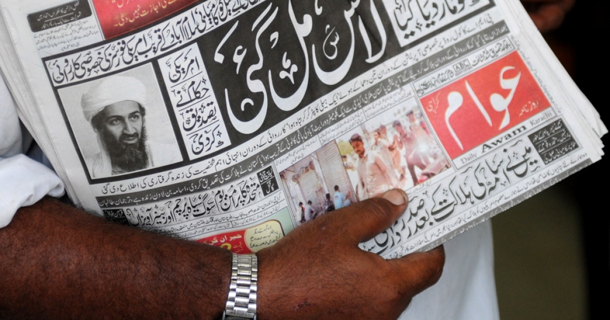 A Pakistani newspaper with headlines of Osama bin Laden's death on a street in Karachi on May 2, 2011. Bin Laden was killed in a highly sensitive intelligence operation in the suburbs of Abbottabad, 30 miles northwest of the Pakistani capital Islamabad, it was announced on May 2, 2011.</p>