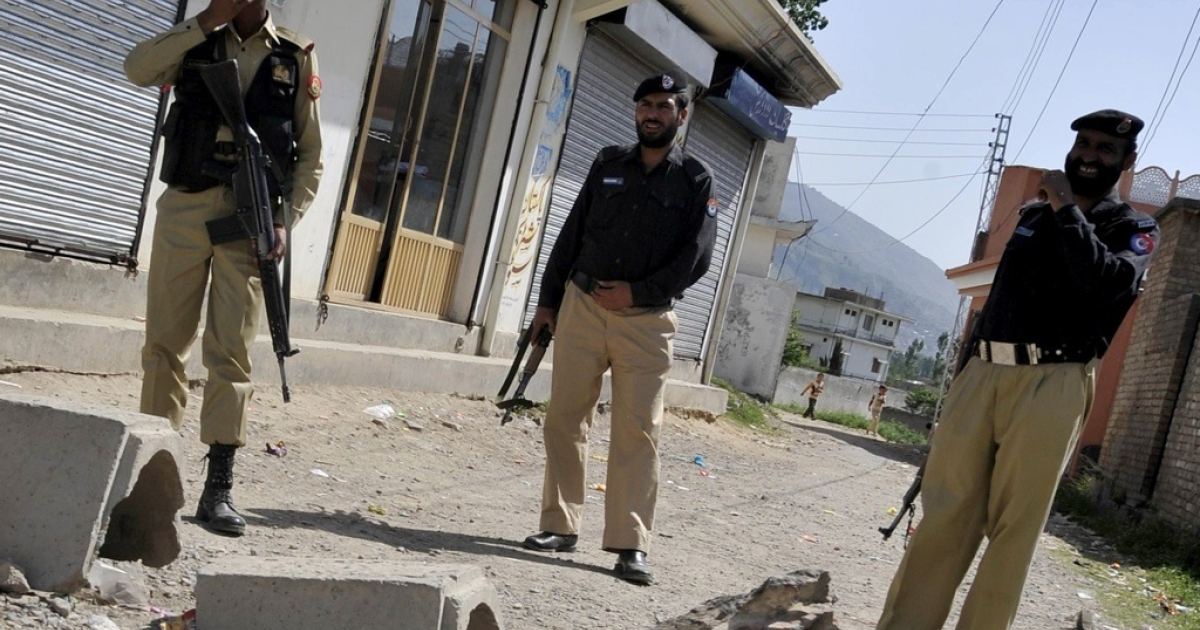 Pakistani military and police officials cordon off a street leading to the final hideout of Osama Bin Laden in Abboattabad on May 9, 2011. Pakistan announced an official probe into the question of how bin Laden could live in a garrison city.</p>