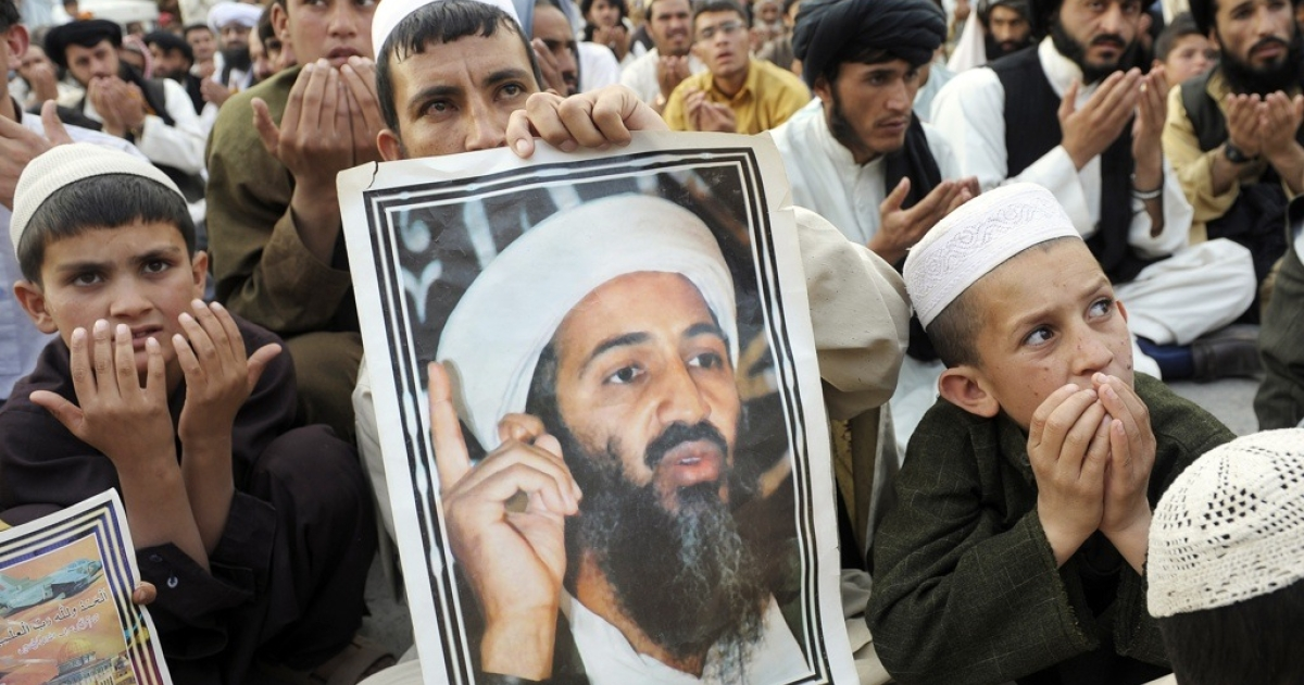 Supporters of hard line pro-Taliban party Jamiat Ulema-i-Islam-Nazaryati carry portraits of slain Al Qaeda leader Osama bin Laden as they pray for bin Laden during an anti-US rally in Quetta, Pakistan on May 2, 2012, the first anniversary of the death of Osama bin Laden. Pakistan was in a state of high alert on May 2, over fears militants will launch revenge attacks on the first anniversary of Osama bin Laden's killing by American Navy SEALs.</p>
