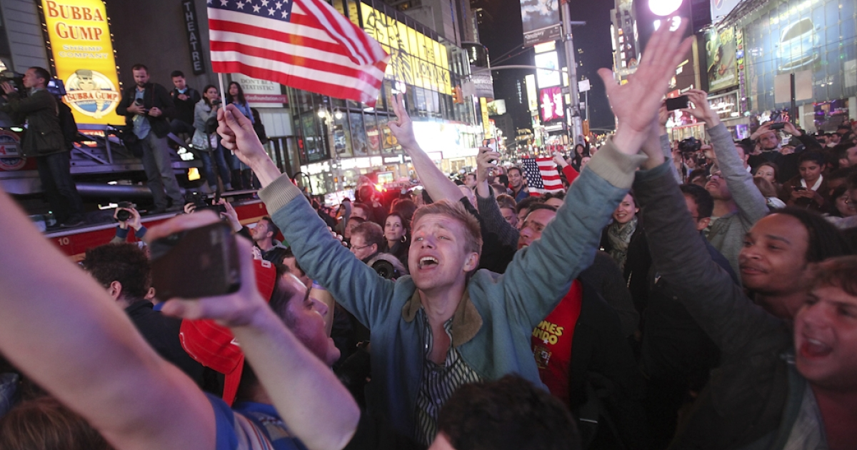 People celebrate in Times Square after the death of accused 9-11 mastermind Osama bin Laden was announced by U.S. President Barack Obama May 2, 2011 in New York City. A special force led operation has killed Osama Bin Laden in a house outside Islamabad in Pakistan and his body is in U.S. custody.</p>