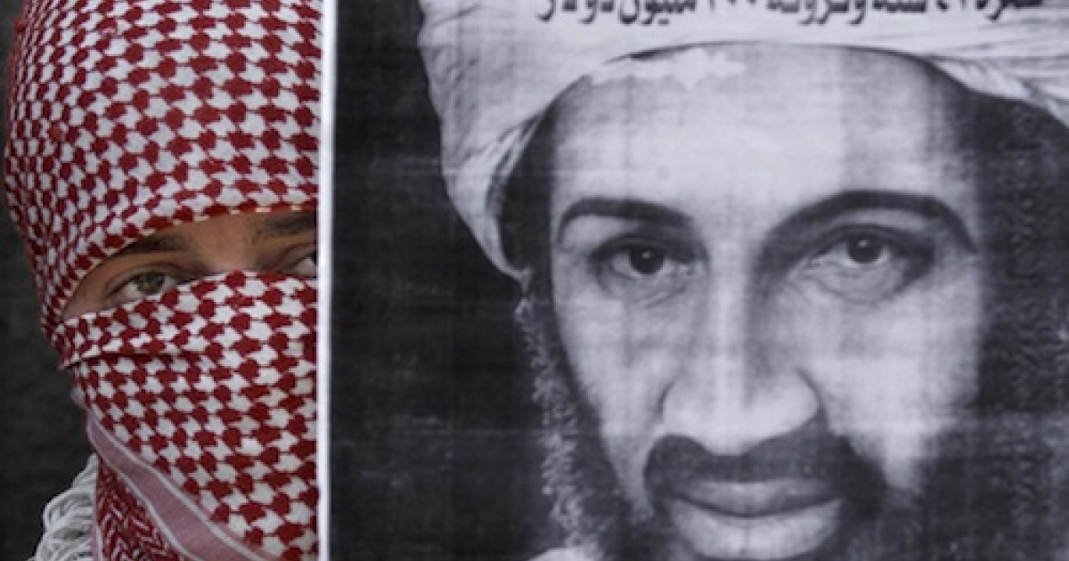 A Palestinian militant from the Islamic Jihad movement displays a portrait of Saudi dissident Osama bin Laden in July 2001. Since his death, sympathetic radicals have hailed the al-Qaeda chief as a