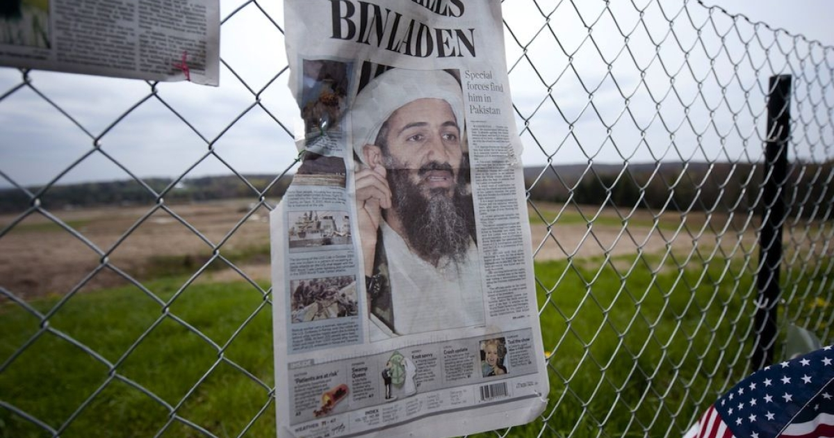 Newspapers left by visitors grace the fence overlooking the crash site of Flight 93 in Shanksville, Pa on May 2, 2011 following the announcement that Osama Bin Laden had been killed in Pakistan.</p>