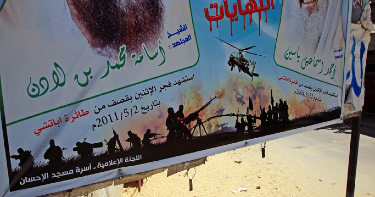A recently erected martyrdom poster honoring Osama Bin Laden and Hamas co-founder Sheik Ahmed Yassin adorns a main street in Rafah near to the Egyptian border on August 21, 2011 in Rafah, Gaza.</p>
