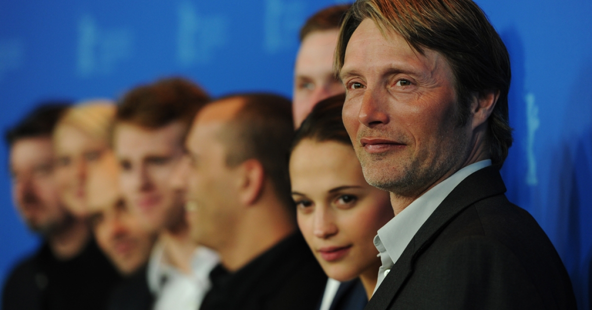 Danish actor Mads Mikkelsen (R) and Swedish actress Alicia Vikander (2nd R) pose next to cast members during a photocall to present his film 'A Royal Affair' (En Kongelig AffÊre ) at the Berlinale International film festival on February 16, 2012 in Berlin. The film was nominated in the Best Foreign Film category for the 2013 Oscars.</p>