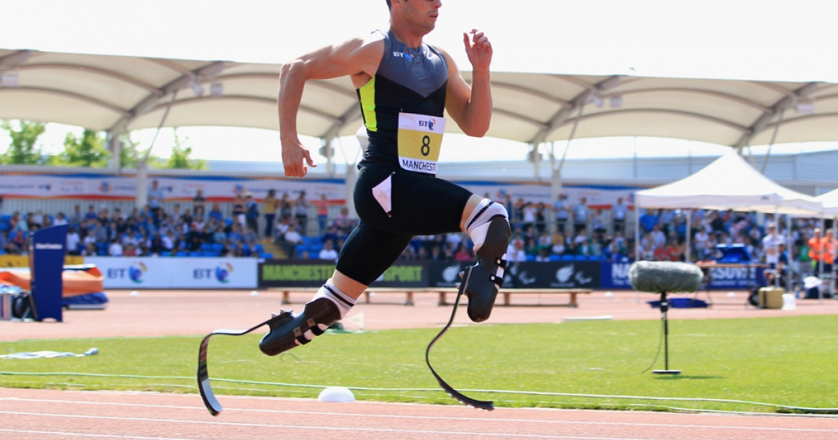 Oscar Pistorius of South Africa wins the men's 200m at the Paralympic World Cup on May 22, 2012, in Manchester, England.</p>