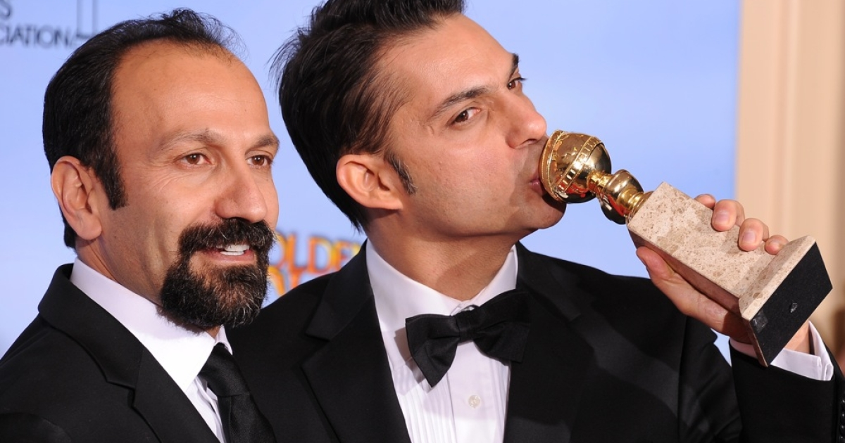 Winners for Best Foreign Language Film 'A Separation' ('Jodaeiye Nader az Simin', Iran) Director Asghar Farhadi and actor-screenwriter Peyman Moaadi (R) poses with the trophy at the 69th annual Golden Globe Awards at the Beverly Hilton Hotel in Beverly Hills, California, January 15, 2012.  The film was nominated for an Oscar this morning.</p>