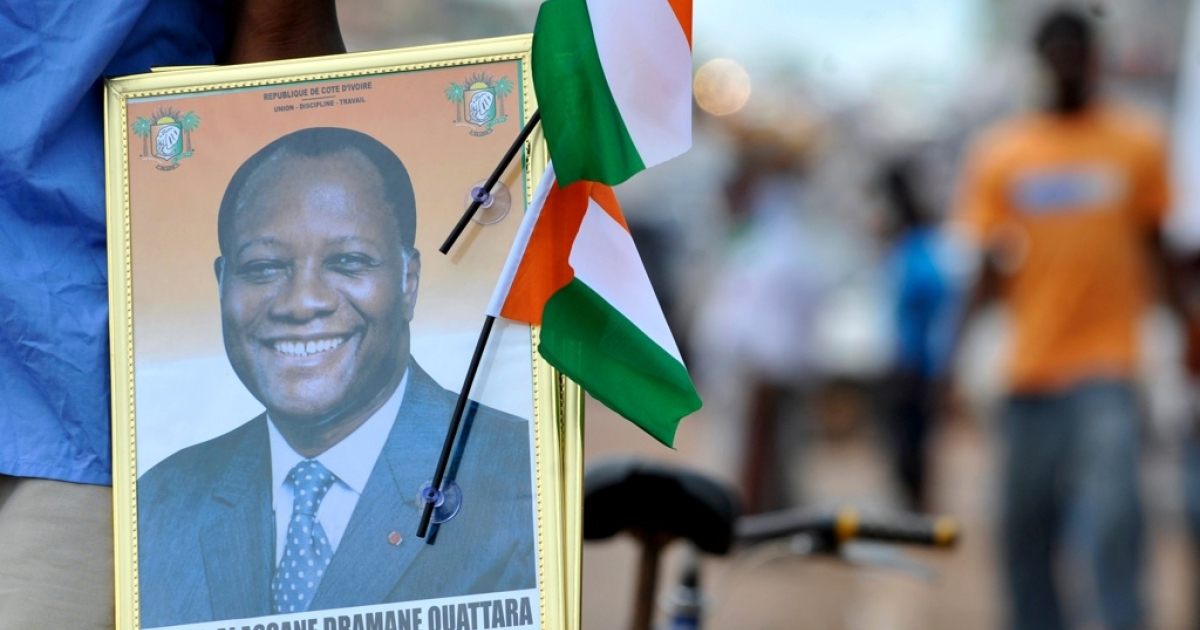 A street vendor sells portraits of Ivory Coast President Alassane Ouattara and Ivorian flags at a market in Yamoussoukro on May 20, 2011, before his investiture ceremony which is due to be held on May 21. Alassane Ouattara is due to be sworn on May 21 as the president of long-troubled Ivory Coast, which he hopes to reunite after a bloody crisis when his predecessor refused to step down.</p>