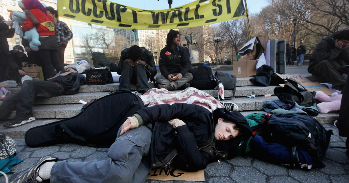 Protesters affiliated with Occupy Wall Street gather in Union Square on March 19, 2012 in New York City.</p>
