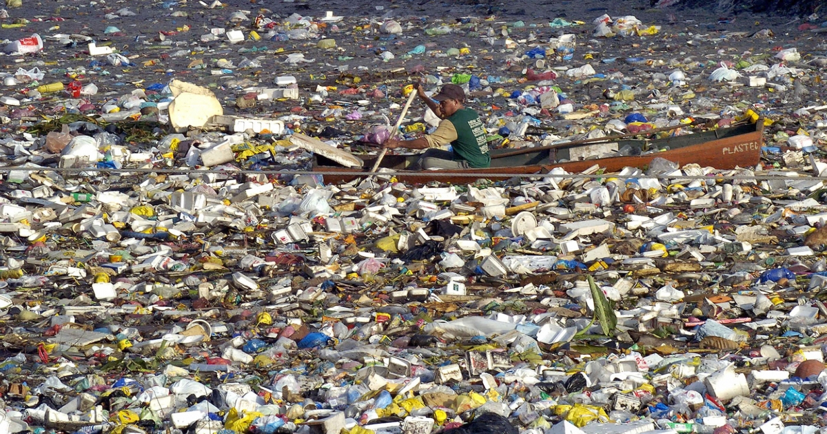 Hawaii has banned the use of plastic bags at grocery stores in an effort to help the environment. Here a scavenger in a dugout canoe paddles through a sea of garbage along a Manila waterway.</p>