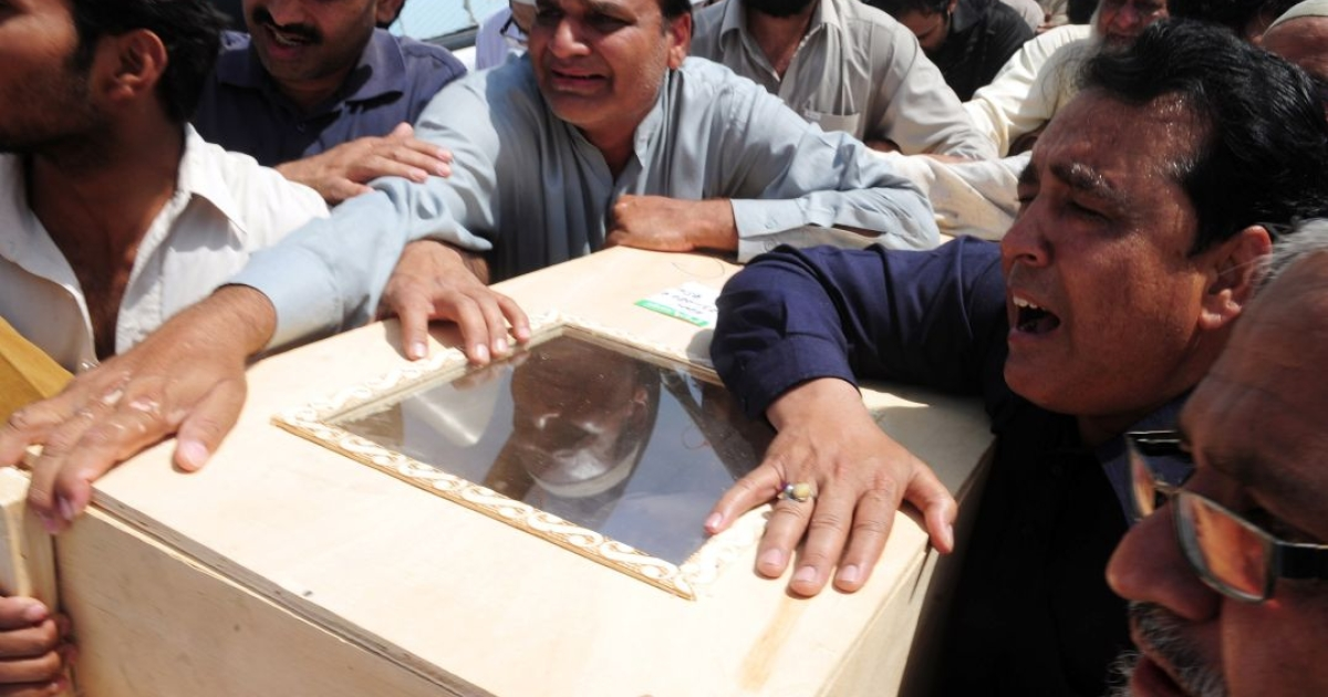 Mourning relatives in Karachi carry the coffin of a passenger killed in the Bhoja Air accident.  All 127 people on board died when the Boeing 737 from Karachi crashed and burst into flames as it attempted to land at Islamabad's airport on Apr. 20.</p>