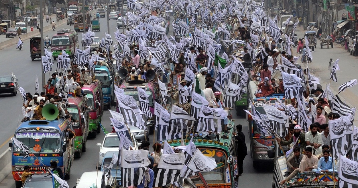 Supporters of The Defense of Pakistan coalition take part in a protest rally from Lahore to Islamabad.  They oppose their country's anti-terror alliance with Washington and are angered by the reopening of a NATO supply route to Afghanistan.</p>