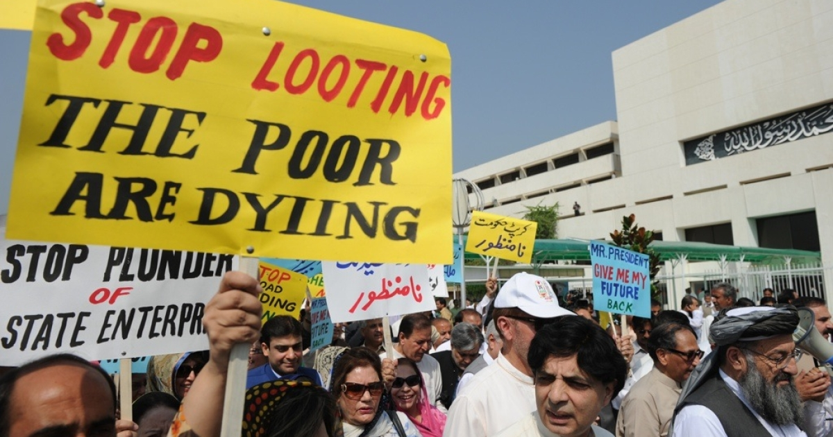 Pakistani protesters march in front of parliament during a rally in Islamabad on Oct. 6, 2011.</p>