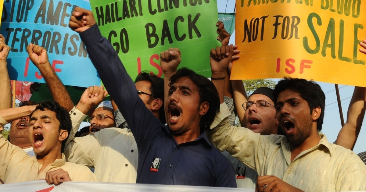 Pakistani protesters shout anti-U.S. slogans during a demonstration against the visit of Secretary of State Hillary Clinton in Lahore on May 27, 2011.</p>