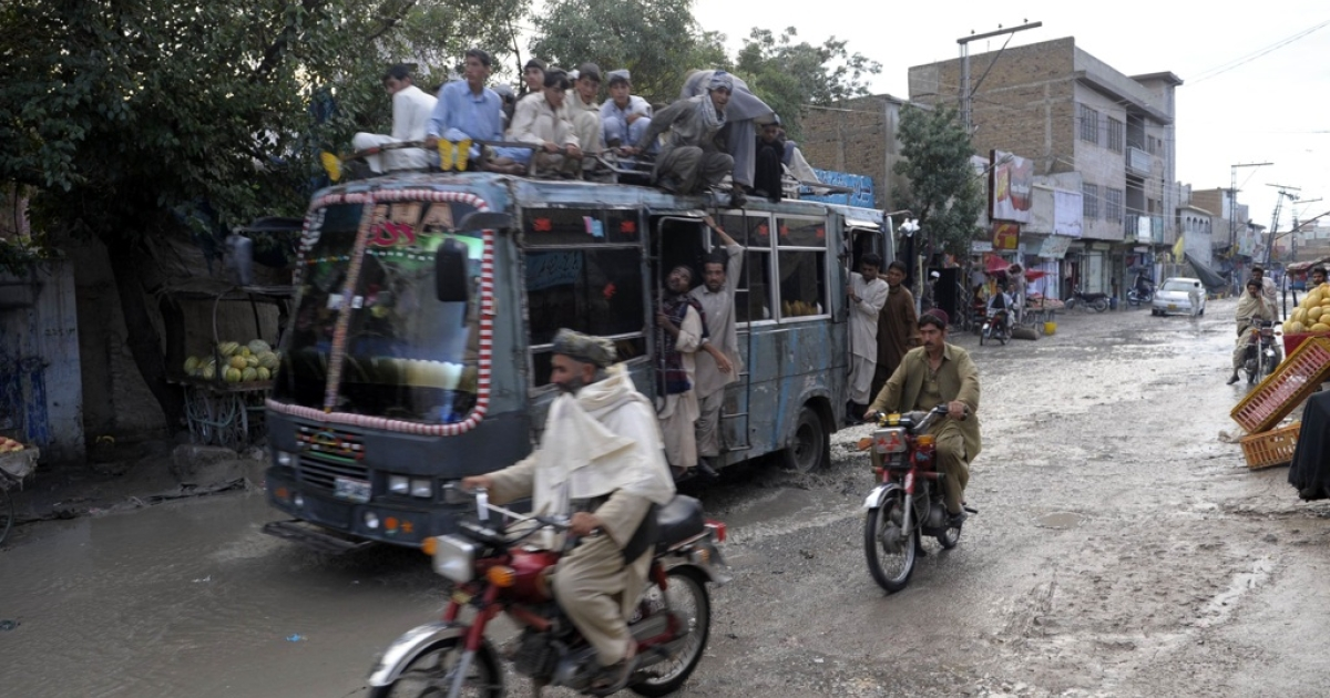 Pakistani commuters travel on an overloaded passenger bus in Quetta, Pakistan, on Sept. 5, 2011.</p>