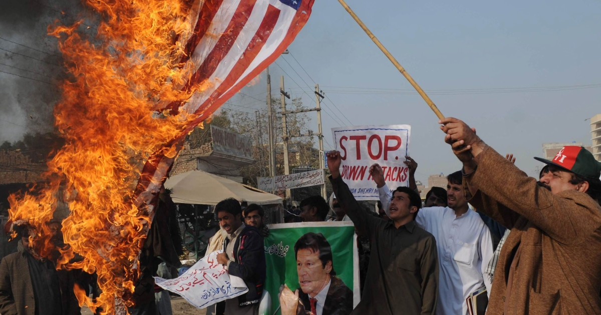 A Pakistani protester burns a US flag in the city of Multan during a demonstration last month against US drone strikes in Pakistani tribal areas.</p>