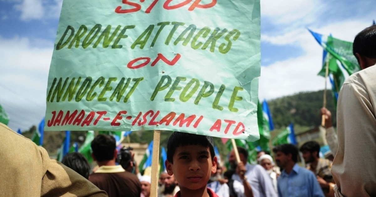 An activist in Abottabad, Pakistan holds a placard during an anti-U.S. protest in May 2011.</p>