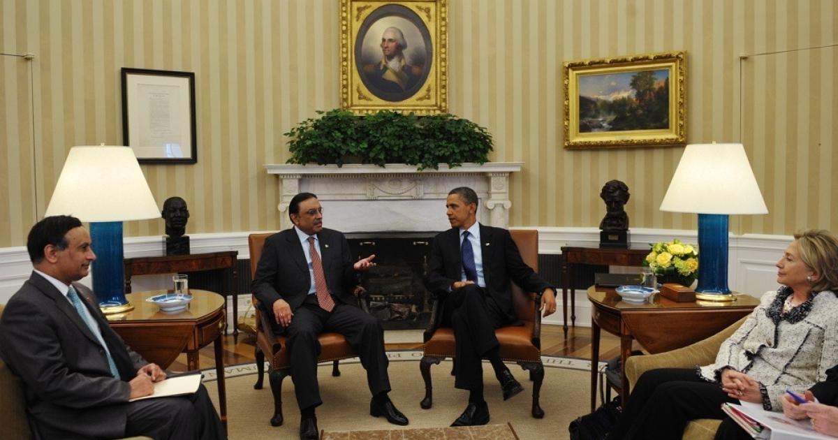 Pakistan President Asif Ali Zardari speaks at a meeting with US President Barack Obama on Jan. 14, 2010 in the Oval Office of the White House. Pakistan's ambassador to the US, Husain Haqqani, and US Secretary of State Hillary Clinton look on.</p>
