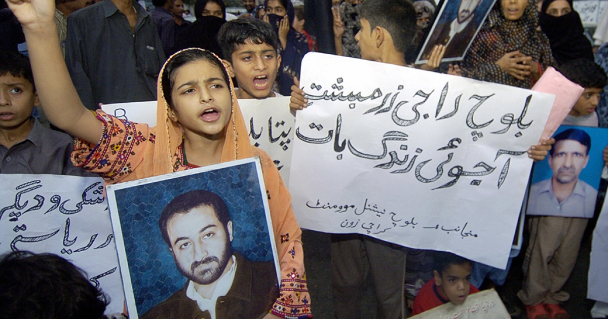 Pakistani missing persons families hold pictures of their missing people as they staged a demonstration in Karachi in 2007. Scores of individuals and civil liberty groups observe the International Human Rights Day in Pakistan.</p>