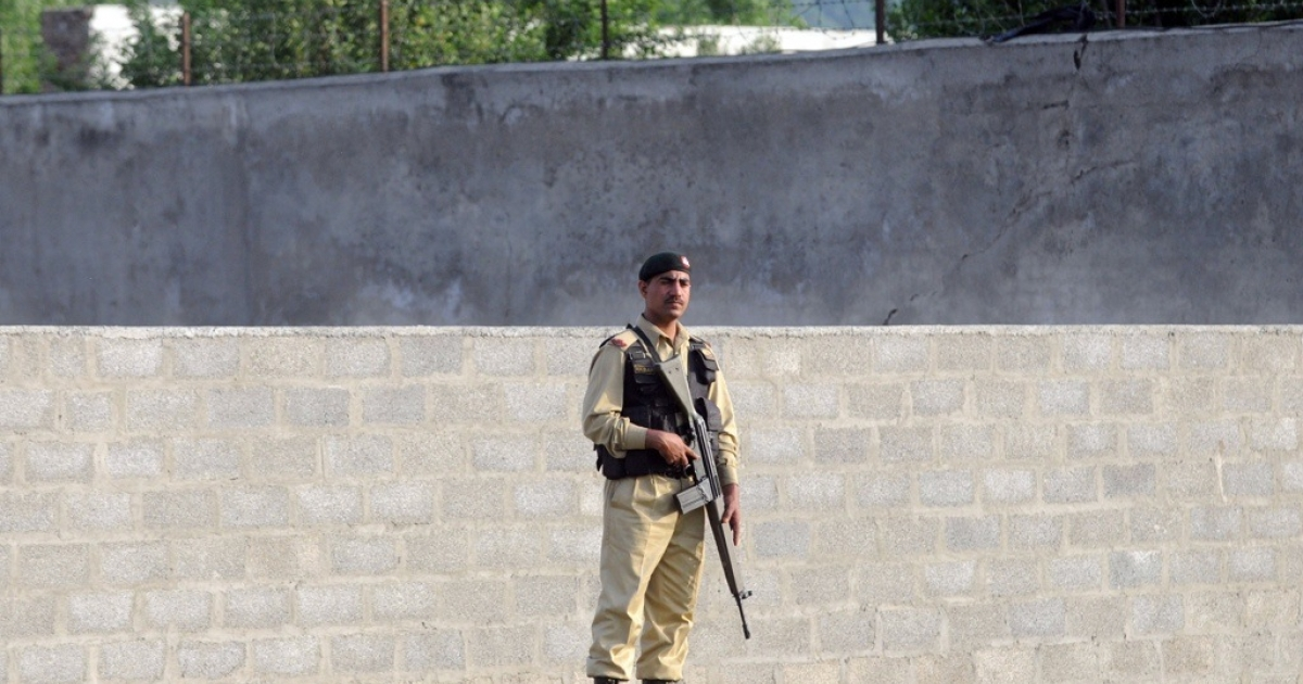 A Pakistani army soldier stands guard in front of Osama bin Laden's final hiding place in Abbottabad on May 5, 2011.</p>
