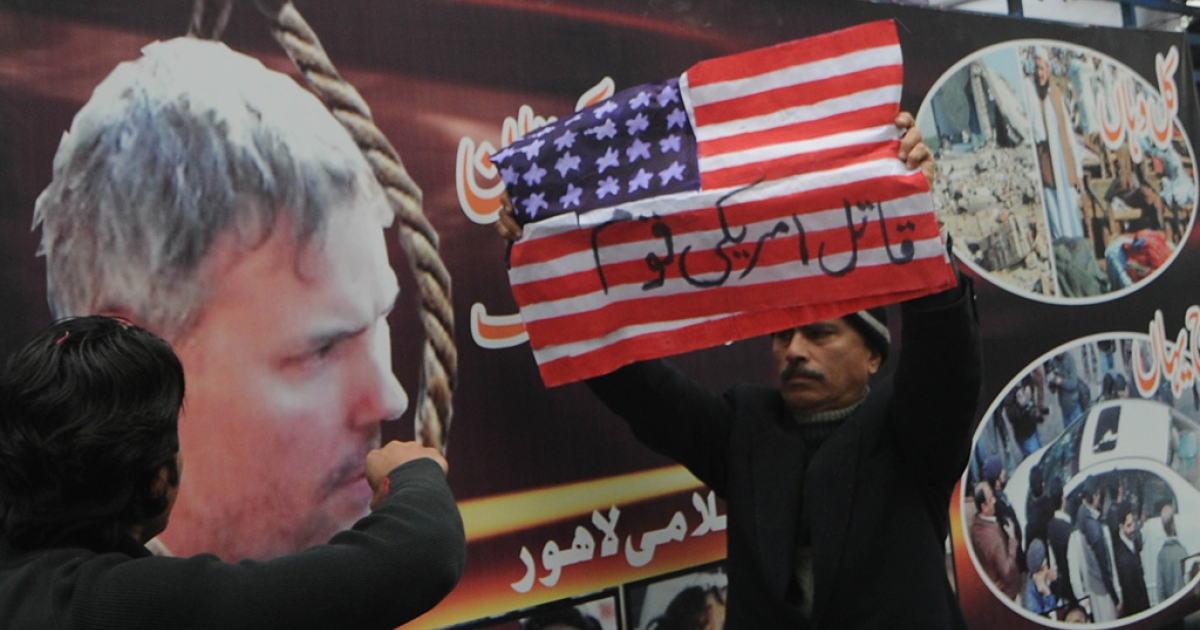 Activists of Jamaat-e-Islami Pakistan shout slogans during a protest against the U.S. consulate worker Raymond Davis in Lahore on Feb. 20, 2011.</p>