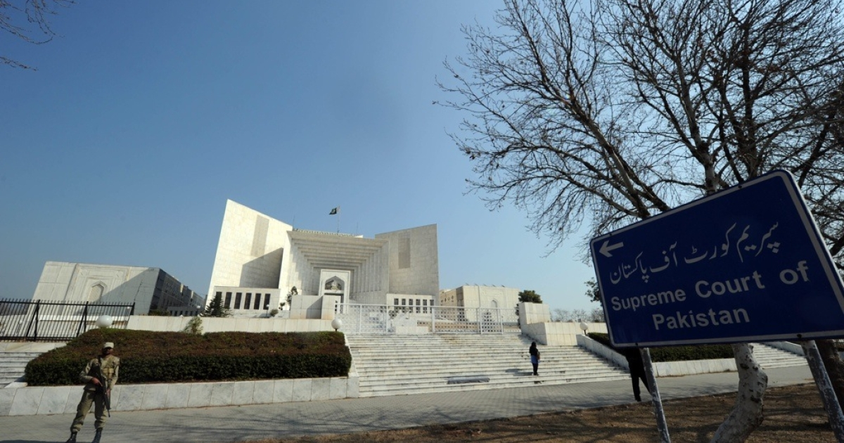 A Pakistani soldier stands guard outside the Supreme Court building in Islamabad on Feb. 10, 2012.</p>