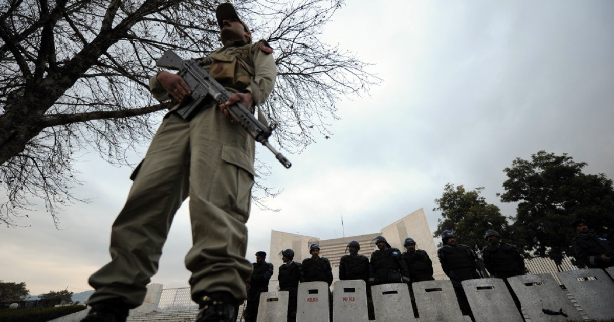 Pakistani security personnel stand guard outside the Supreme Court building during a hearing in Islamabad on Jan. 19, 2012.</p>