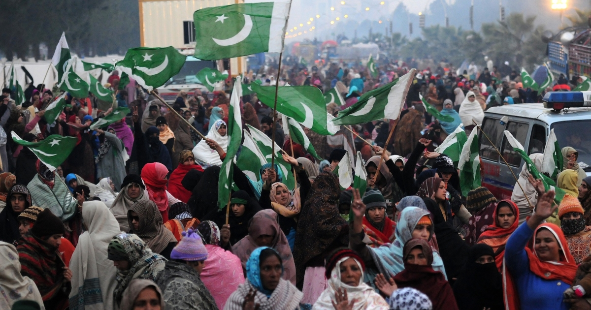 Supporters of Pakistani cleric Tahir-ul Qadri wave flags on the third day of the protest rally in Islamabad on January 16, 2013. Pakistan's opposition parties on Wednesday backed the government against any