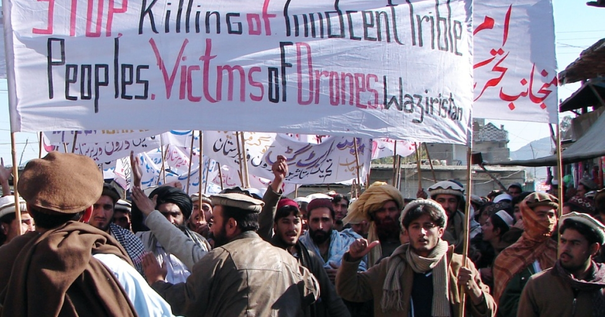 Pakistani tribesmen hold banners as they march during a protest rally against US drone attacks, in Miranshah, the main town in North Waziristan district on January 21, 2011. Hundreds of Pakistani tribesmen paraded in the streets to demand an end to US drone attacks which they said were killing innocent people in the tribal areas, witnesses said. In 2010 the campaign doubled missile attacks in the tribal area with around 100 drone strikes killing more than 650 people, according to an AFP tally.</p>