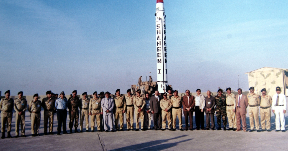 In this photo released by Pakistan Ministry of Defense, Vice chief of Army Staff, General Ahsan Saleem Hyat stands alongside scientists and officials in front of Pakistan's domestically-produced short-range, nuclear-capable missile December 8, 2004, at an undisclosed location in Pakistan.</p>