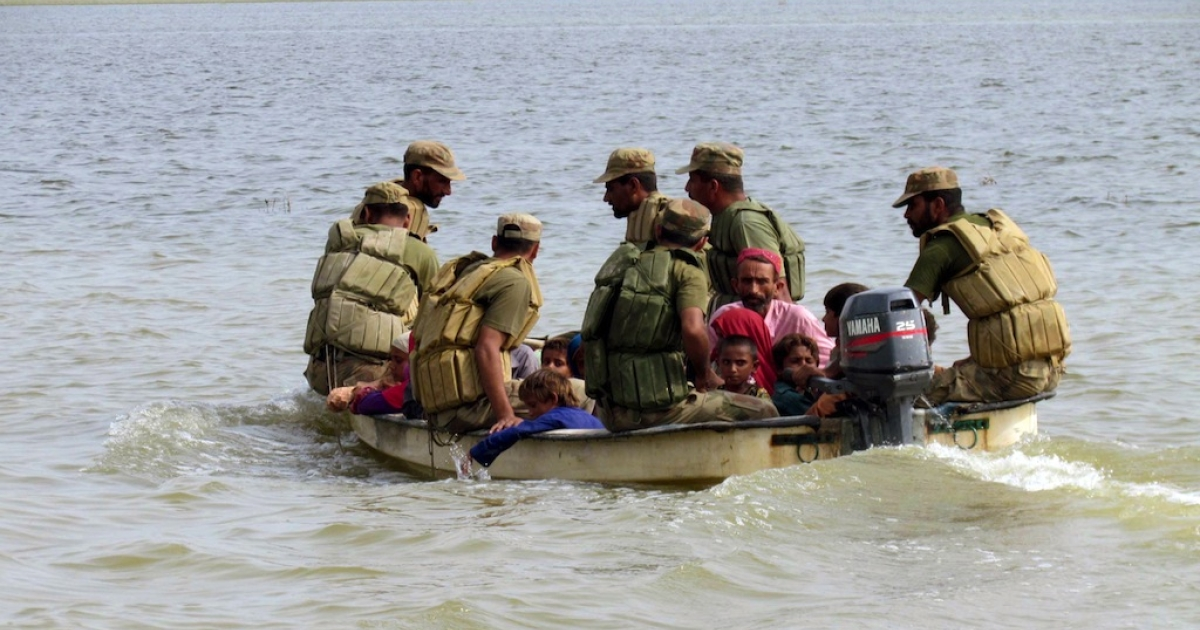 Pakistani soldiers rescue villagers in the flood-hit Jacobabad district of Sindh province on Sept. 17, 2012.</p>