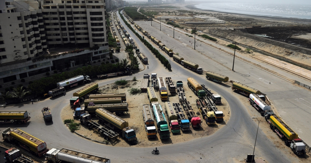 Fuel tanker trucks, used to transport fuel to NATO forces in Afghanistan, are seen parked along a road in Pakistan's port city of Karachi on June 12, 2012. Pakistan told the US on July 3, 2012, that it would reopen NATO supply routes into Afghanistan.</p>