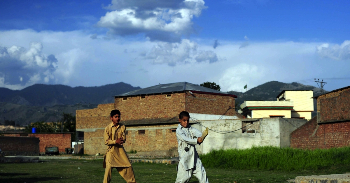Pakistani youths play cricket near the final hideout of Al Qaeda chief Osama Bin Laden in Abbottabad on May 9, 2011, where bin Laden was killed in a US Naval Commandos special operation. Pakistan said it was