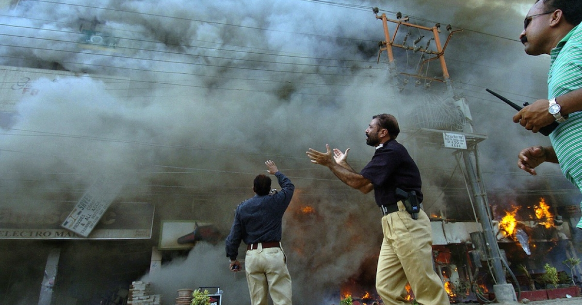 Pakistani fire-fighters extinguish a burning Pizza Hut after an angry mob set it on fire in Karachi on July 15, 2006. Protestors torched the restaurant, a gas stations and a dozen cars after the funeral of Shiite cleric, Hassan Turabi, who was killed in a suicide bombing the previous day.</p>