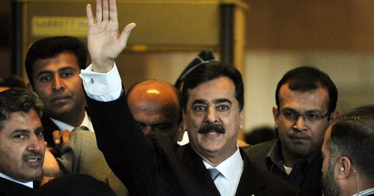 Pakistani Prime Minister Yousuf Raza Gilani waves as he arrive at the Supreme Court in Islamabad on February 13, 2012.</p>