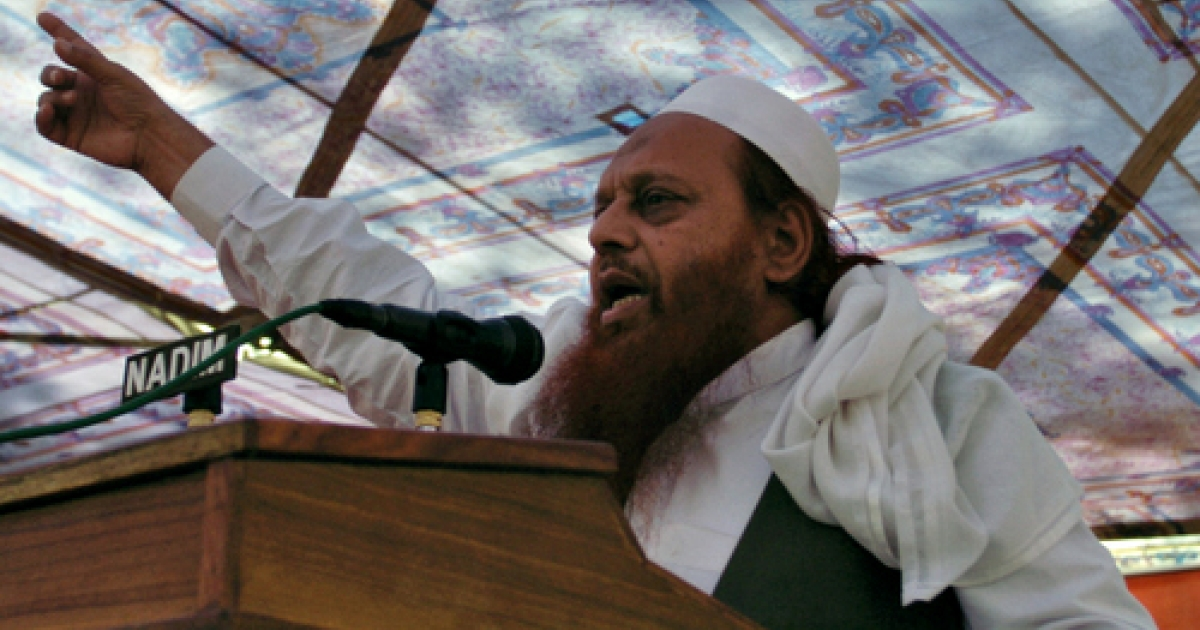 Abdul Wahid Kashmiri, a Lashkar-e-Taiba commander, speaks during a rally in Muzaffarabad on October 27, 2010, to mark Black Day. Kashmiris on both sides of the Line of Control are observing Black Day, which marks the anniversary of Indian troops arriving in Kashmir on October 27, 1947, after the Himalayan region's Hindu ruler requested help to fend off an invasion by Pakistan-backed tribesmen.</p>