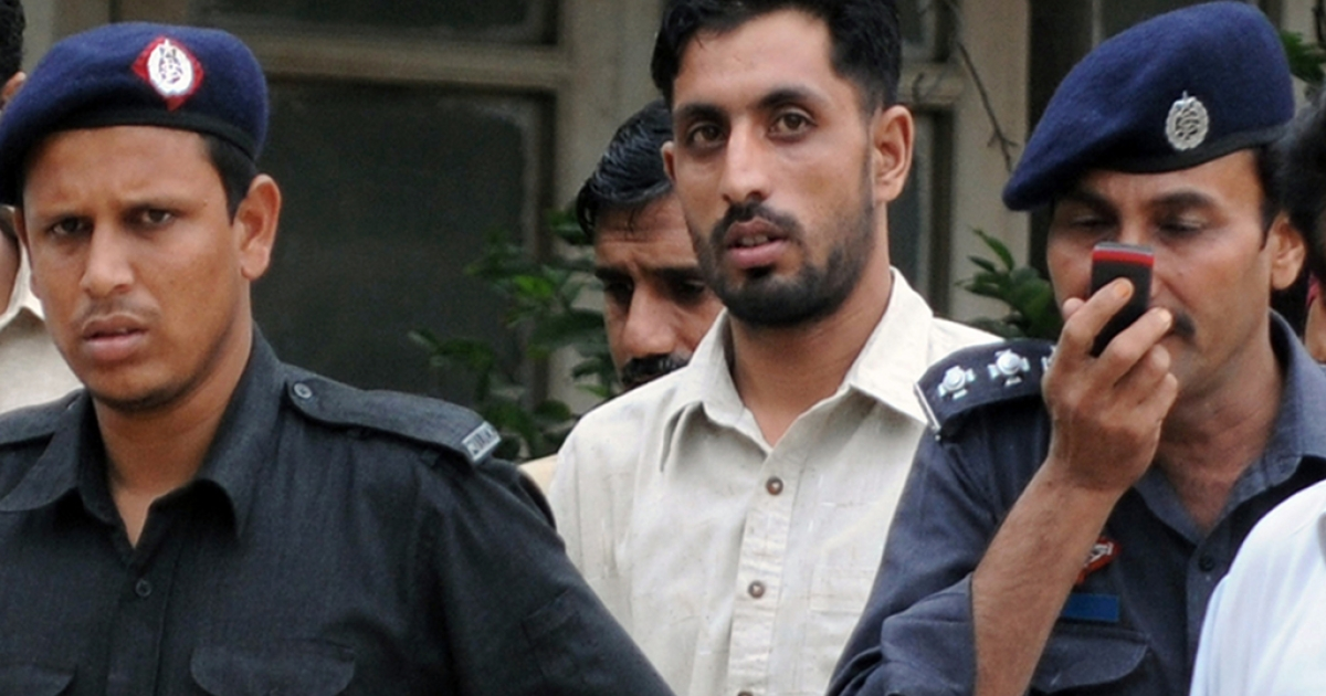 Pakistani paramilitary soldier Shahid Zafar, who shot unarmed youth Sarfaraz Shah at point blank range on June 8, is escorted to court in Karachi on August 12, 2011.</p>