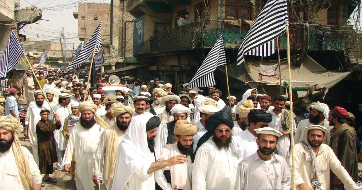 Pakistani tribesmen at a protest rally in North Waziristan district on June 20, 2011, against US drone attacks in Pakistani tribal areas. The CIA lawyer, John Rizzo who signed off on drone