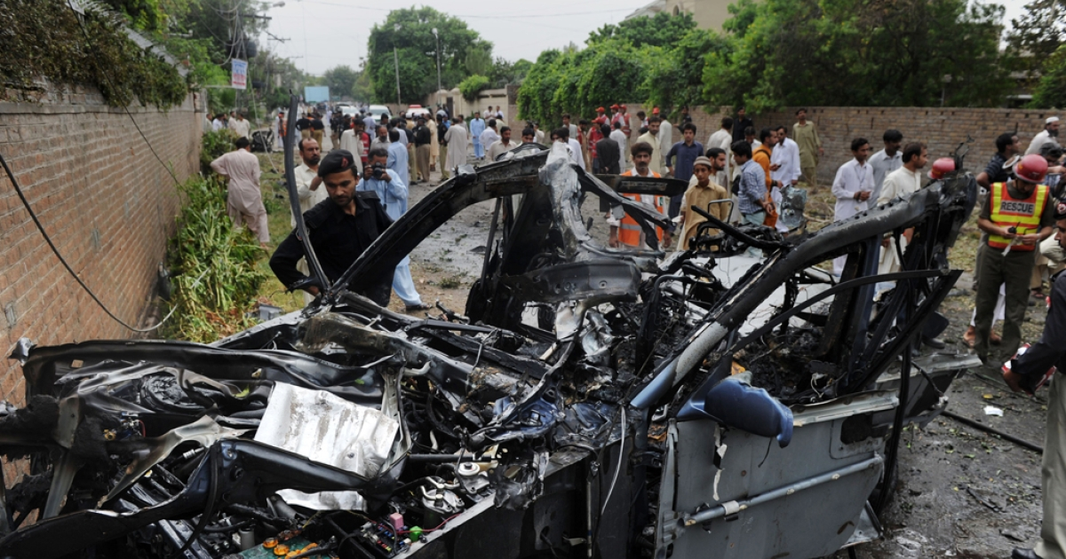Pakistani rescuers and security personnel gather at a bomb blast site in Peshawar on September 3, 2012. The US embassy in Islamabad denied reports that two Americans had been killed in a suicide car bomb attack in Pakistan's northwestern city of Peshawar.</p>