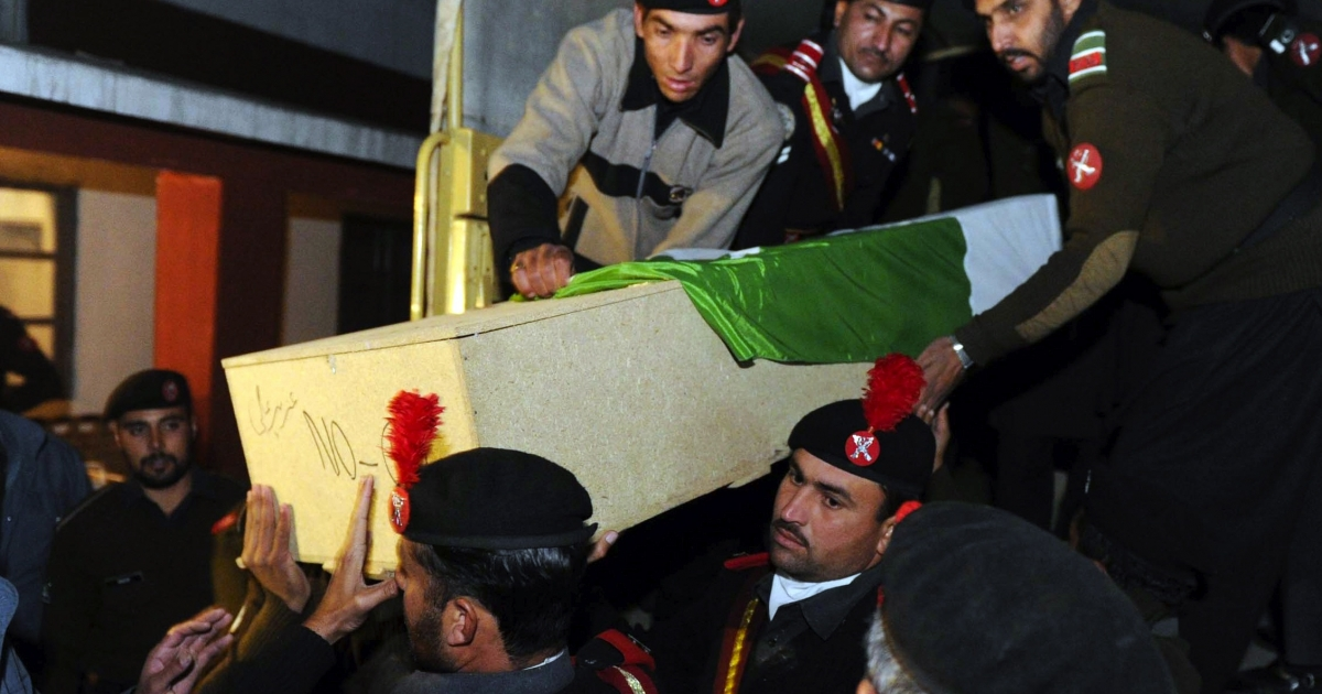 Pakistani Frontier Constabulary soldiers off-load a coffin of a soldier prior to a funeral ceremony in Peshawar on January 5, 2012. The bodies of 15 members of Pakistan's paramilitary Frontier Constabulary (FC) were found on January 5, almost two weeks after they were kidnapped from a northwestern town, officials said. The Tehreek-e-Taliban Pakistan (TTP) spokesman Ehsanullah Ehsan claimed responsibility for the killings, telling AFP: 'We have taken revenge for continued operations of security forces against us.</p>