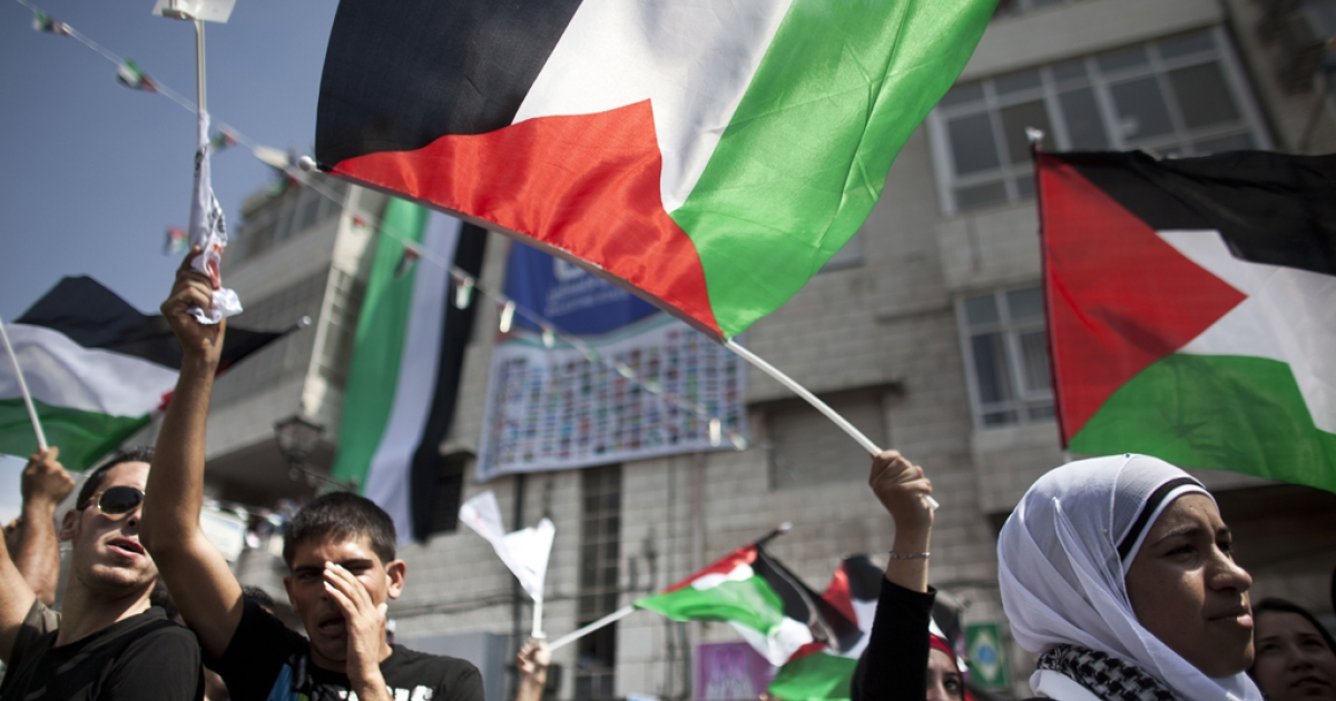 Palestinians attend a demonstration in support the Palestinian bid for recognition of statehood at the United Nations on Sept. 21, 2011 in Ramallah, West Bank.</p>