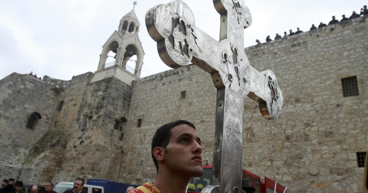 A parade in Bethlehem as Christian Orthodox Christmas celebrations kick off.</p>
