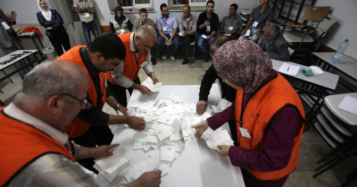 Palestinian poll officials count the votes at a polling station in the West Bank city of Hebron on October 20, 2012. Polling stations were closed in the West Bank after 12 hours of voting in the first Palestinian election since 2006, with voters casting their ballots in a municipal poll that was boycotted by Hamas.</p>