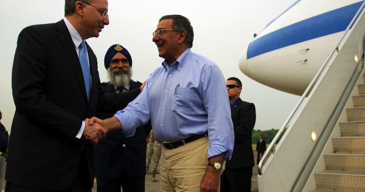 US Ambassador to Singapore David Adelman (L) shakes hands with Secretary of Defense Leon Panetta (R) as Commander Air Power Generation Command Colonel Sarbjit Singh (C) looks on upon Panetta's arrival at Paya Lebar Airfield in Paya Lebar, Singapore on June 1, 2012.</p>
